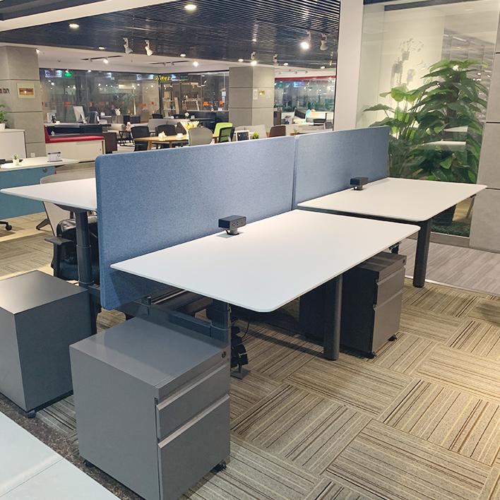 应怎样选择安全可靠的电动升降桌子?